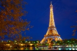 Eiffel Tower lit-up by night, Paris