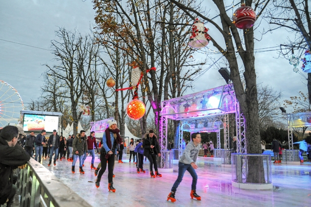 Ice skating at Le Marché de Noël des Champs-Elysées, Paris, France